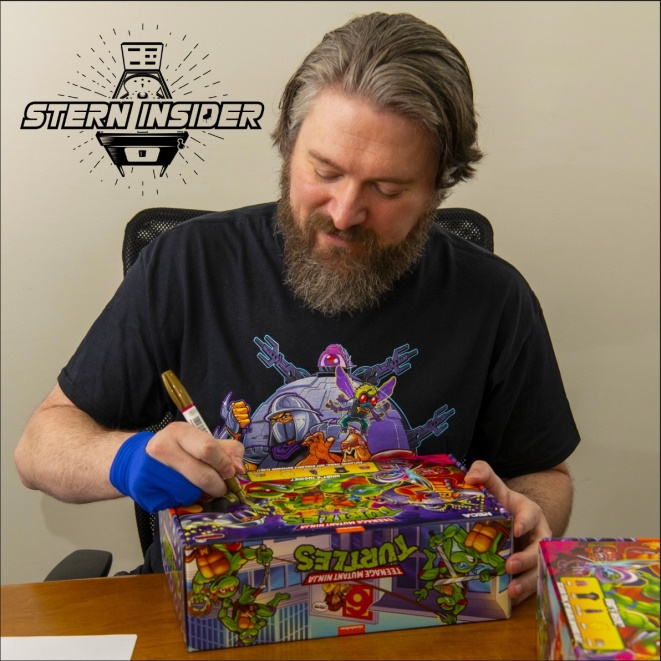 Zombie Yeti authographing a TMNT Loot Crate